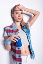 Blonde girl in patriotic denim vest holding soda can with straw and looking at camera Royalty Free Stock Photo