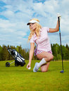 Blonde girl play golf Stock Photography