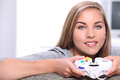Blonde girl playing video games Stock Photo