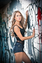 Blonde girl posing fashion near graffiti wall Stock Images