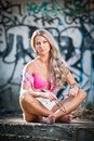 Blonde girl posing fashion near graffiti wall Stock Image