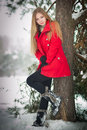 Blonde girl with red coat in winter snow Stock Photography