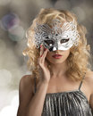 Blonde girl with silver mask on the face Royalty Free Stock Photo