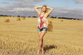 Blonde girl in sloping field Royalty Free Stock Photo