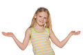 Blonde girl spreads his hands white background Stock Photo
