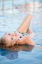 Blonde girl in swimming pool Stock Images