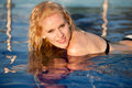 Blonde girl in swimming pool Stock Photography