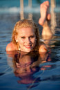 Blonde girl in swimming pool Royalty Free Stock Photography