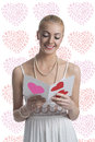 Blonde girl takes a valentine postcard Stock Photos