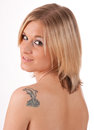 Blonde girl with tattoo portrait of a beautiful blond woman a in her bare shoulder Stock Photography