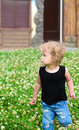 Blonde girl walking on grassplot little in summer Royalty Free Stock Photo