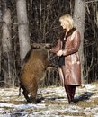 Blonde girl with wild boar Stock Photo