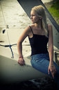 Blonde girl on a yacht cute young posing white by the lake Royalty Free Stock Photography