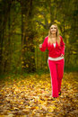 Blonde girl young woman running jogging in autumn fall forest park female runner training outdoor healthy lifestyle outside yellow Royalty Free Stock Photos
