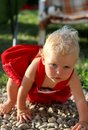Blonde gorgeous baby girl blue eyed red dressed Stock Photos