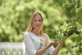 Blonde on a green background portrait Royalty Free Stock Photo