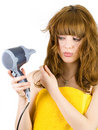 Blonde with hair drier Royalty Free Stock Photography