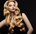 Blonde Hair. Portrait of Beautiful Woman with Long Wavy Hair. Royalty Free Stock Images