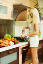 Blonde in kitchen Stock Photo