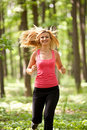 Blonde lady running Stock Photos