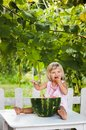 Blonde litle girl eats a slice of watermelon adorable outdoors Stock Photography