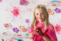 Blonde little girl finger painting Royalty Free Stock Photo