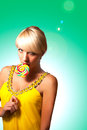 Blonde with lollipop Royalty Free Stock Image