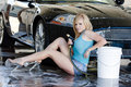 Blonde Model at the Car Wash Royalty Free Stock Photos