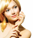 Blonde model girl beauty fashion with golden earrings Stock Photos