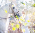 Blonde nymph with the white horse pure Royalty Free Stock Image