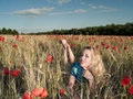 Blonde in poppies Royalty Free Stock Image