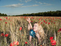 Blonde in poppies Royalty Free Stock Photography