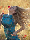 Blonde in poppy field Royalty Free Stock Photos