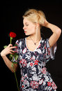 Blonde with rose. Stock Photo