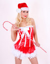Blonde Santa girl with candy cane stick on white Royalty Free Stock Photos
