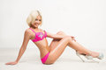Blonde sexy woman in pink fashionable lingerie Royalty Free Stock Photo