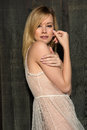 Blonde in sheer lace pretty slender woman a dress Royalty Free Stock Photos