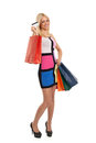 Blonde with shopping bags and credit card attractive in hand Royalty Free Stock Images