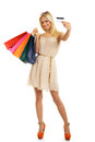 Blonde with shopping bags and credit card attractive in hand Royalty Free Stock Photography