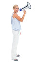 Blonde shouting through megaphone on white background Royalty Free Stock Photography