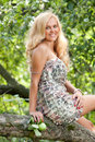 The blonde sits on an apple-tree Stock Photo