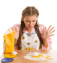 Blonde smashed egg awkward prepares in the kitchen Royalty Free Stock Image