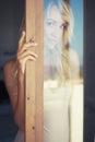 Blonde in the sun art portrait of beautiful through glass Stock Photos