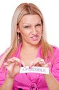 Blonde tearing the word impossible Stock Photography