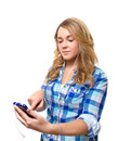 Blonde teenager searching music with smartphone portrait of beautiful a on white background Royalty Free Stock Photography