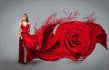 Blonde in windy red and white dress beautiful girl with creative make up Royalty Free Stock Photography