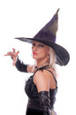 Blonde witch casts a spell pretty woman in costume isolated on white Royalty Free Stock Photo