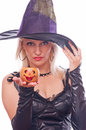 Blonde witch holding jack o lantern beautiful in the costume small decorative isolated on white Stock Images