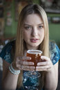 Blonde woman with beautiful blue eyes drinks a goblet of beer portrait drinking Royalty Free Stock Photo