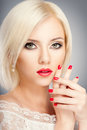 Blonde woman with bright red lips and manicure Stock Images